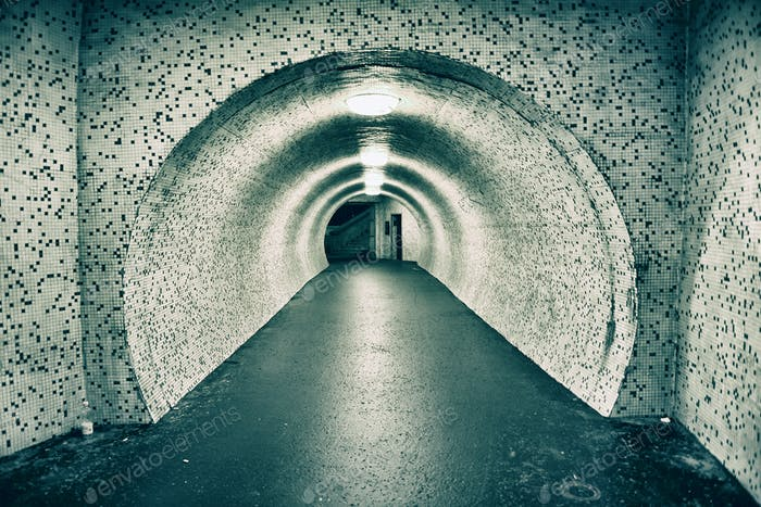 Abandoned old empty underground tunnel. Toned image