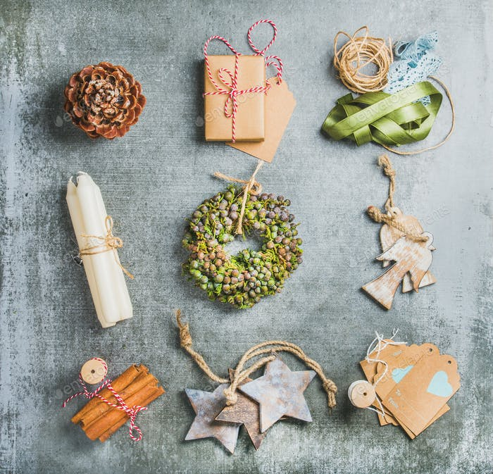 Christmas related objects on grey concrete table background, top view