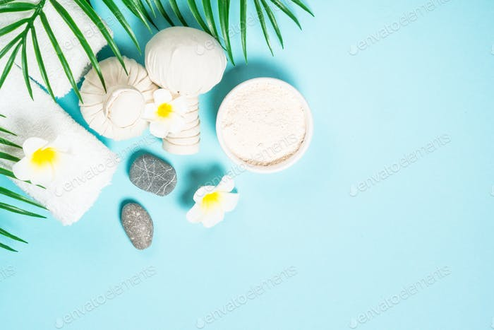 Spa herbal compressing balls on blue background