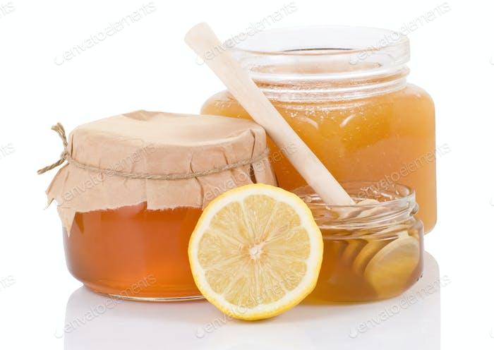 pot full of honey and lemon isolated on white