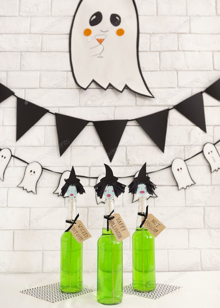Creative children green Halloween cocktails with cute ghost