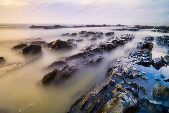 Sea And Waves On Rocks In Portugal Shore