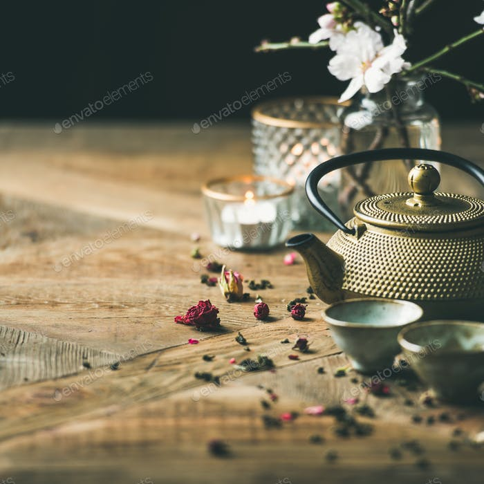 Traditional Asian tea ceremony arrangement over wooden background, square crop
