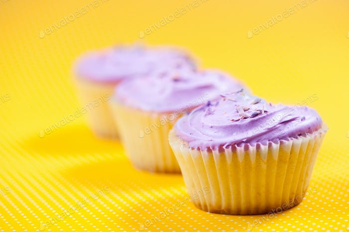 Raspberry muffin with vanilla filling against yellow background