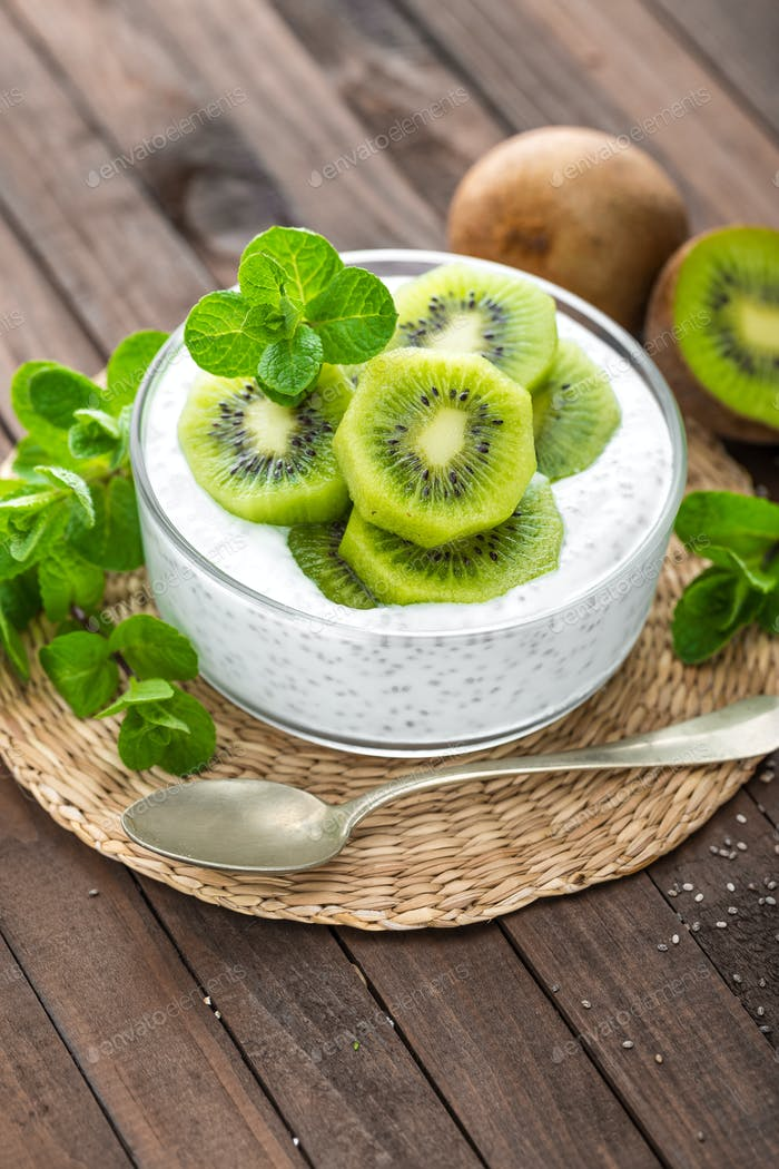 Fresh kiwi yogurt with fruits and chia seeds, healthy breakfast