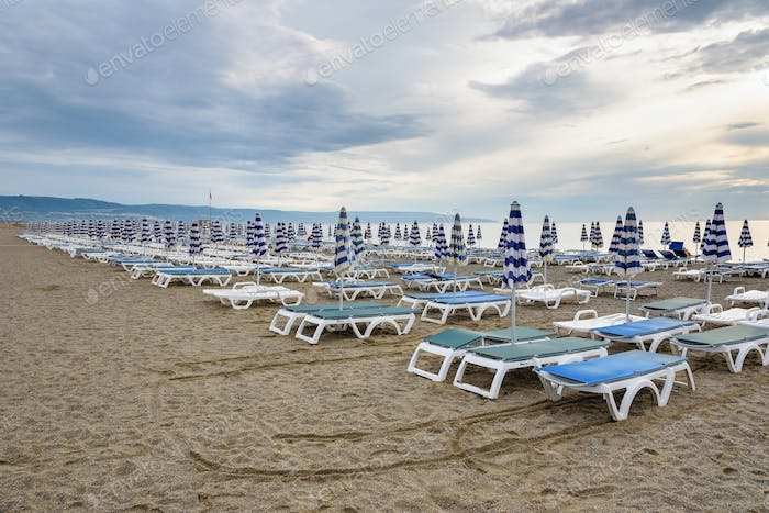 Sunbeds and umbrellas on the calabrian beach