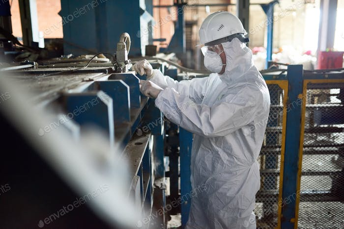 Worker in Hazmat Suits at Modern Factory