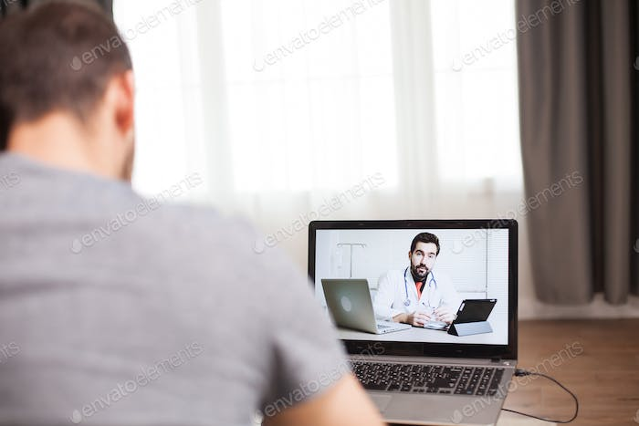 Man having a video conference with his doctor