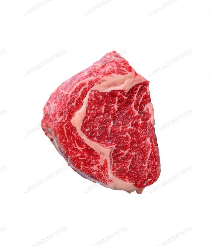 Raw marbled ribeye steak isolated on white