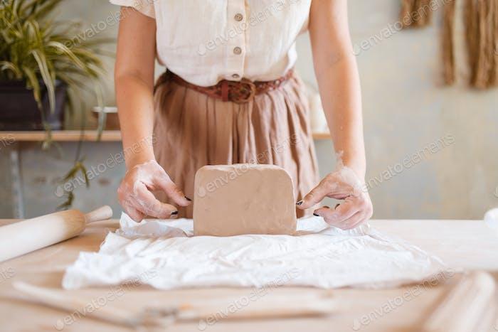 Female potter prepares a foarm, pottery workshop