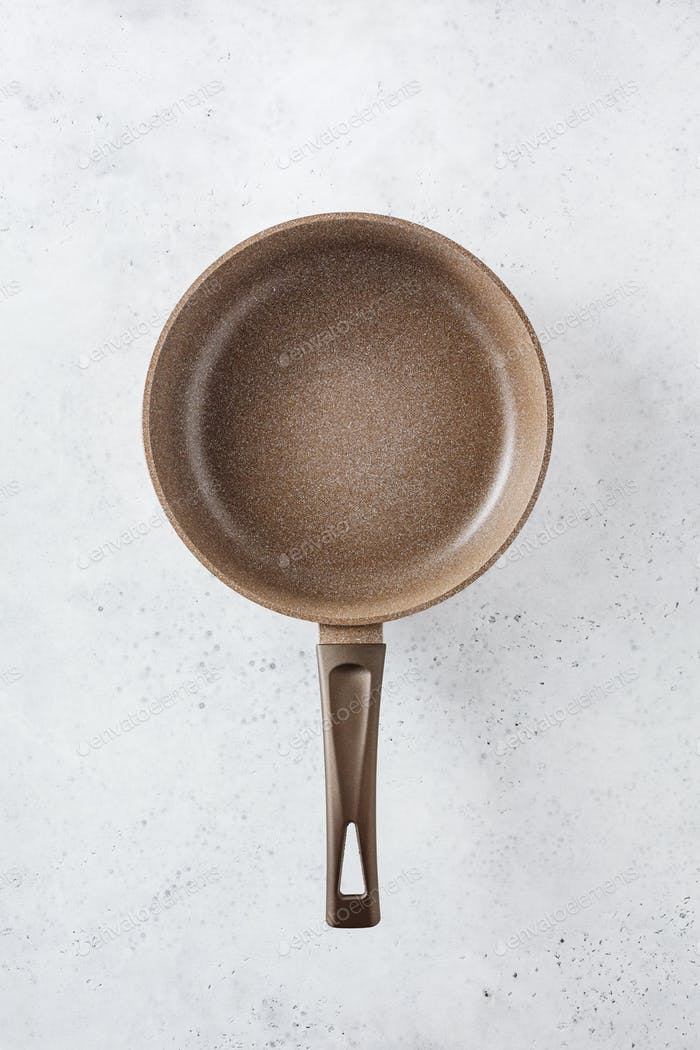 Brown frying pan with a non-stick coating