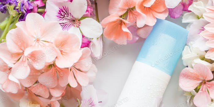Face moisturizer in water with flowers