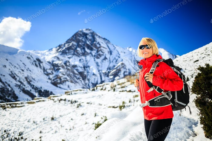 Woman hiker happy walking in Himalaya Mountains, Nepal