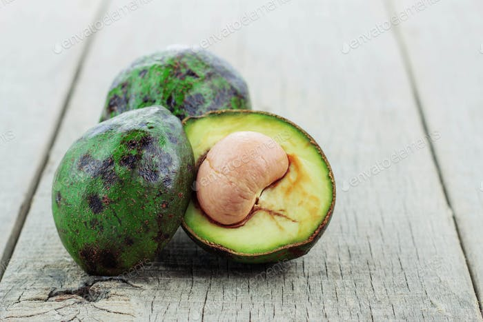 Avocado cut on wooden
