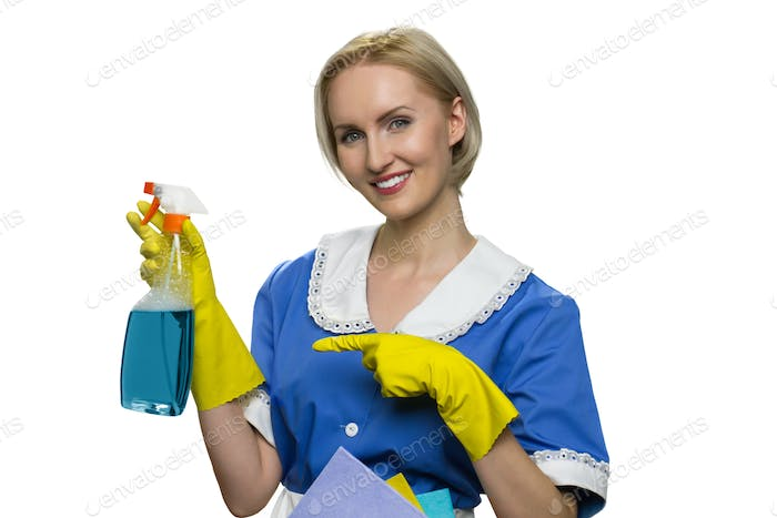 Housekeeper in uniform, yellow rubber gloves cleaner spray on white background