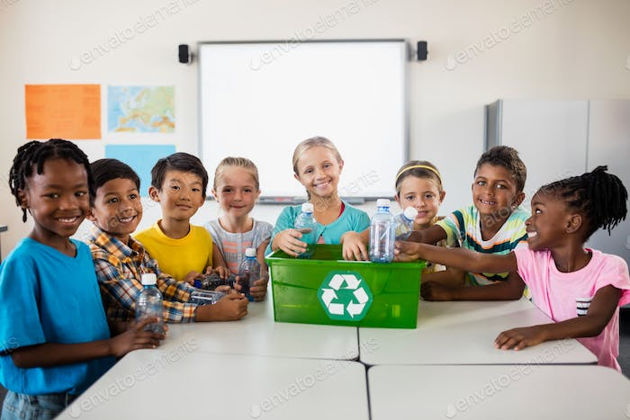 Portrait of pupils recycling