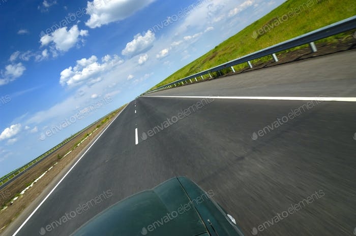 Top view of a car is a smooth highway
