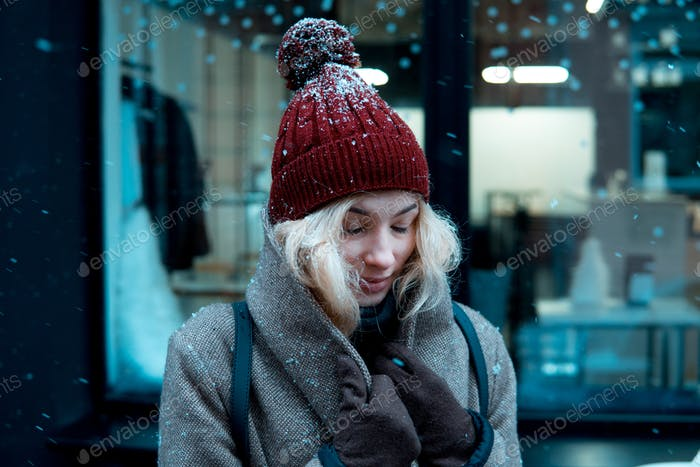 girl on a winter walk in the city, snow, outside