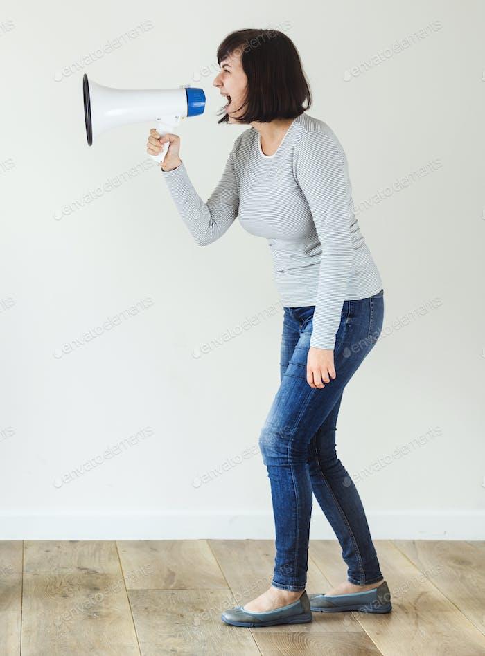 Woman using megaphone for annoucement