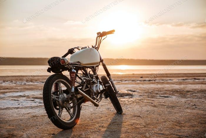 Retro motorcycle standing in the desert