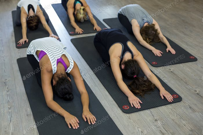 Group of women performing stretching exercise