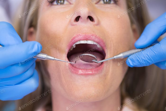 Close up of dentist examining patient