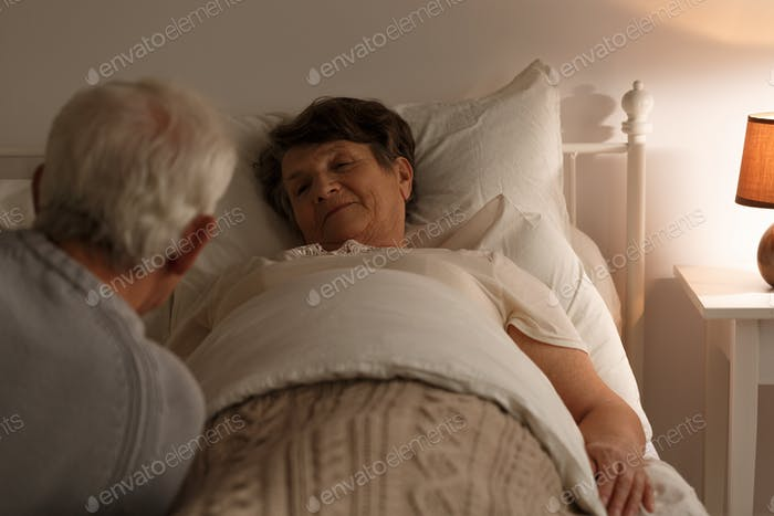Senior woman in a bed