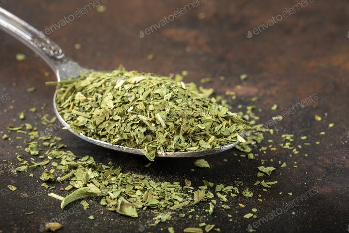 Spoon filled with dried lovage