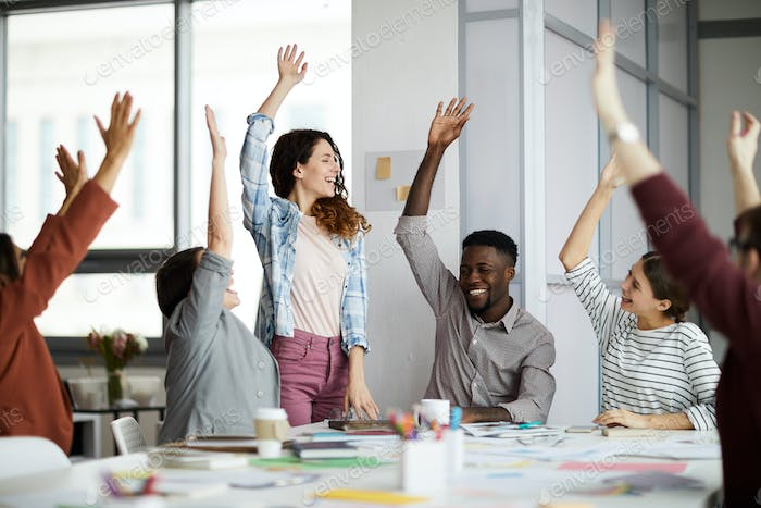 Contemporary Business People Raising Hands
