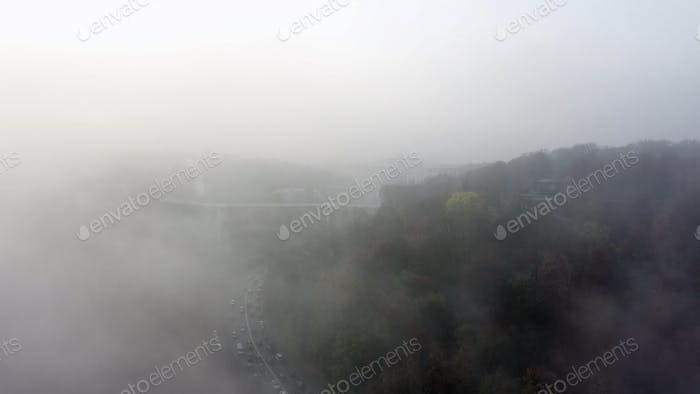 A city covered in fog. City traffic, aerial view