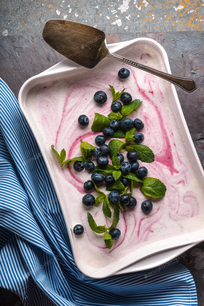 Semifreddo  with blueberry and mint in the ceramic dish on the stone background vertical