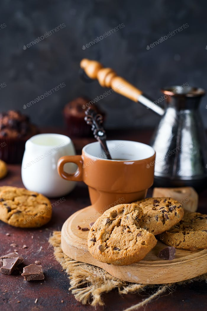Chocolate cookies in plate and cup of hot coffee