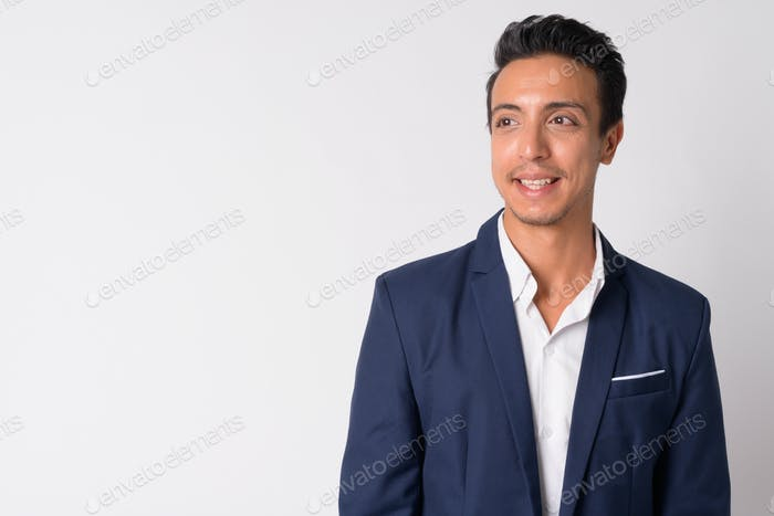 Portrait of happy Hispanic businessman thinking against white background