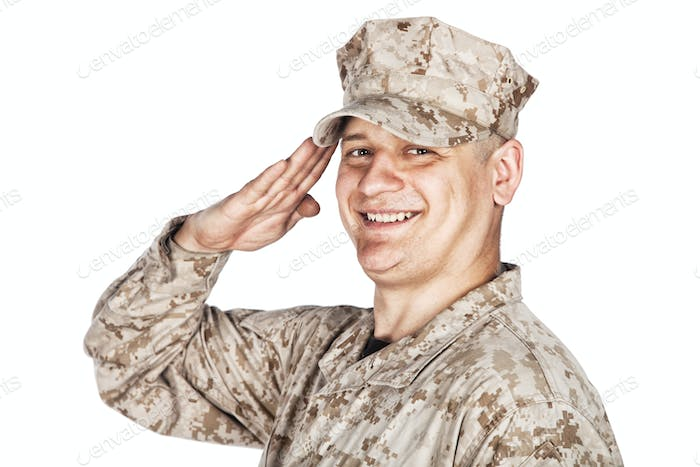 Saluting and smiling army soldier studio shoot