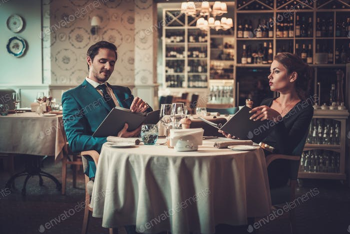 Couple reading menu in a restaurant
