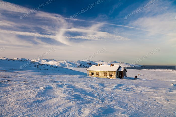 Winter landscape with cabin hut