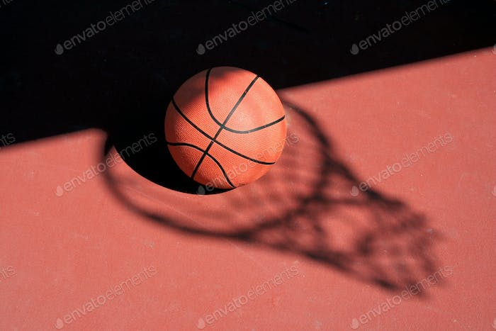 Basketball and net shadow