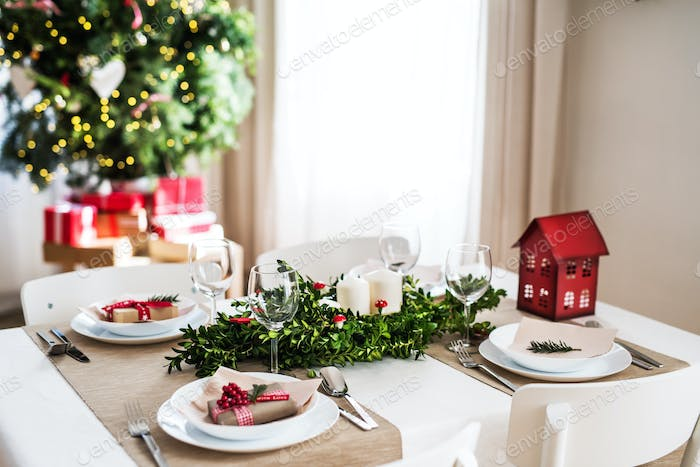 A table set for a dinner at home at Christmas time.
