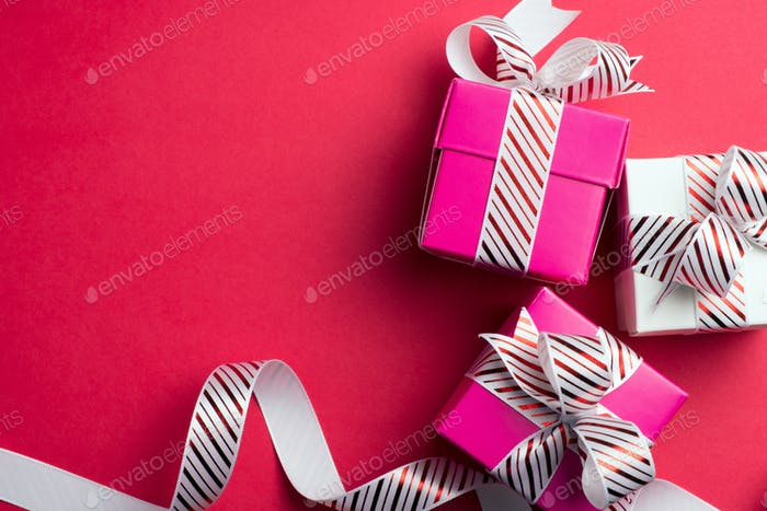 White and pink gift boxes with stripe ribbon