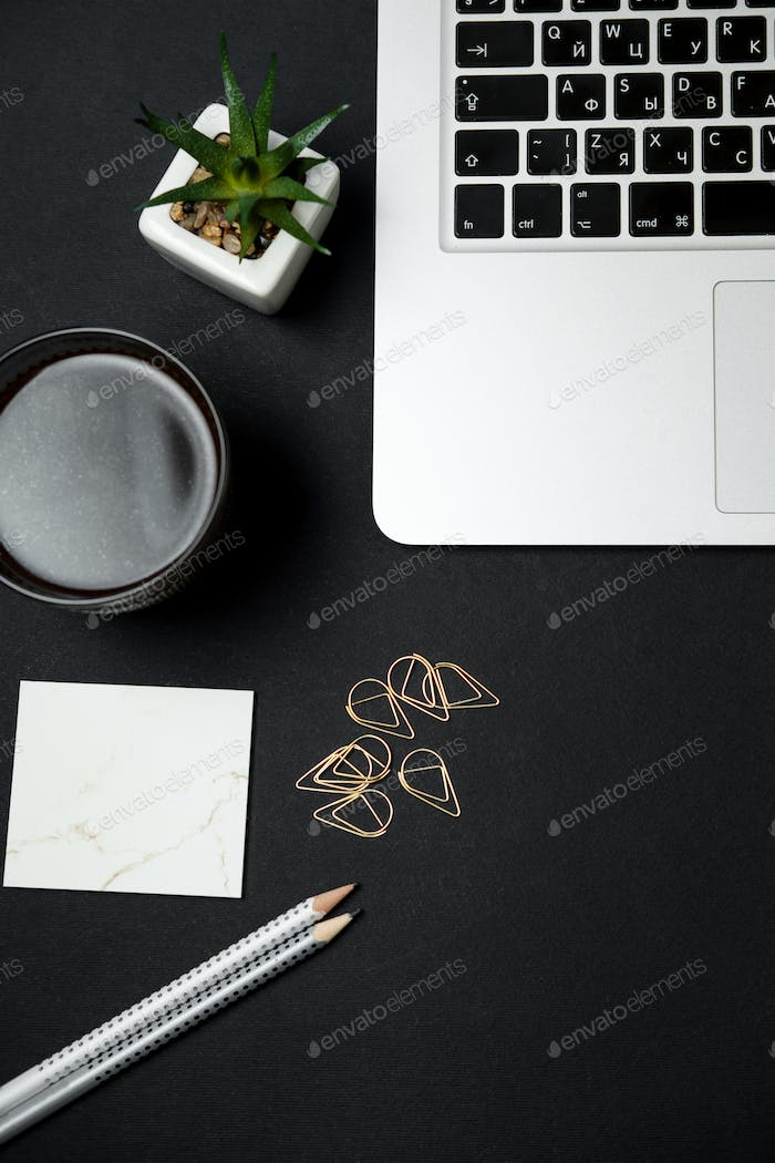 Modern business work space with Bitcoin, laptop, coffee, stationery