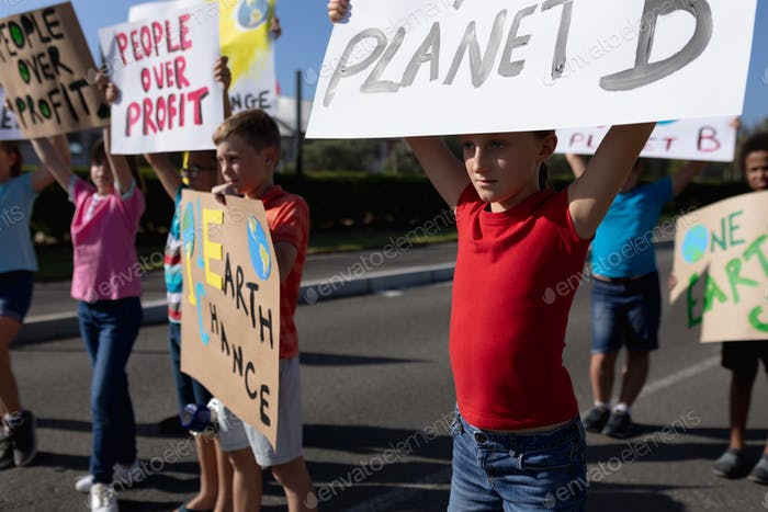 Group of elementary school pupils walking on a protest march