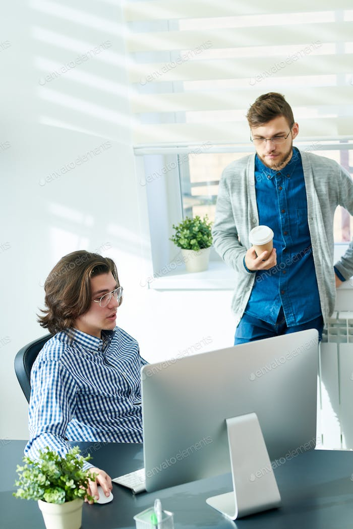 Smart young businessmen working in office