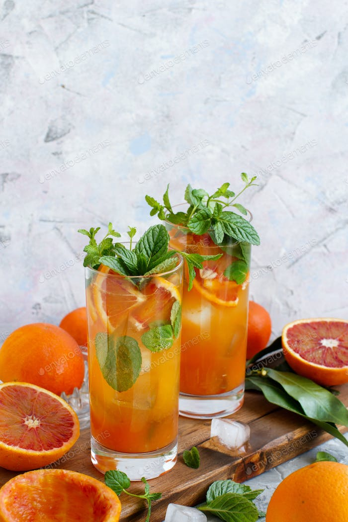 Homemade refreshing drink with bloody orange juice and mint