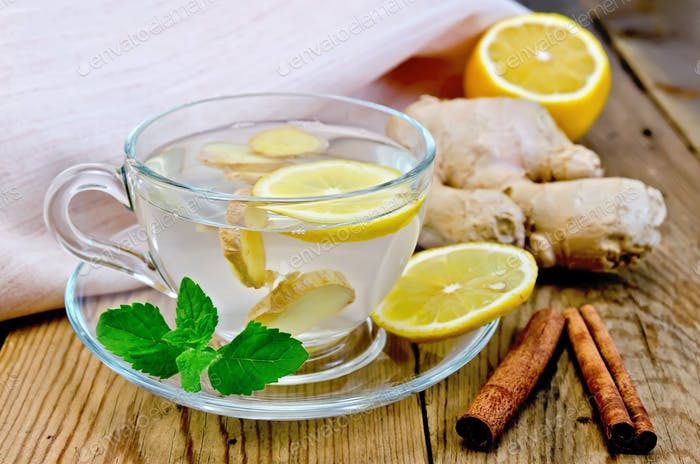 Tea ginger with lemon and cinnamon on board