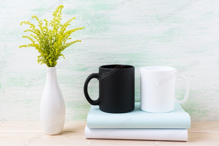 White and black mug mockup with ornamental green flowering grass