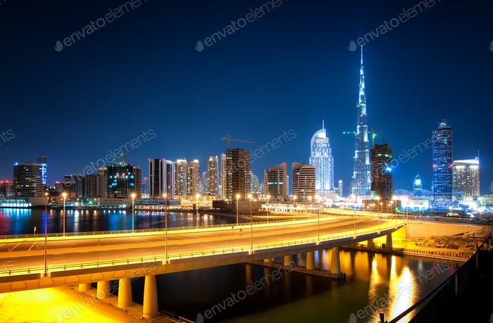 Tallest skyscrapers in Business Bay district during night. Dubai, United Arab Emirates.