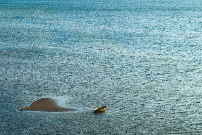Lonely fishing boat at he sea
