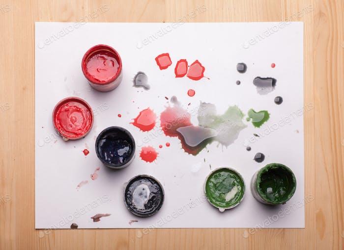 gouache paints on wooden table