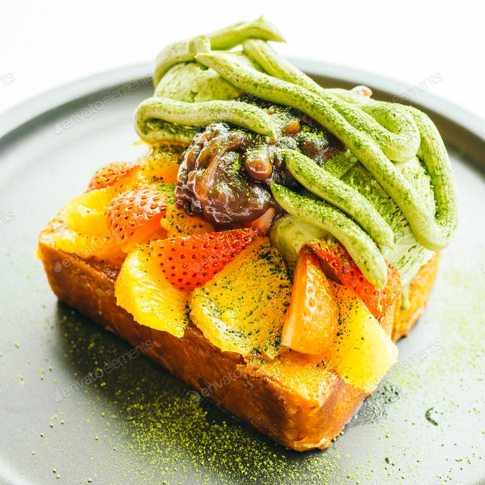 Sweet dessert bread toast with matcha ice cream and strawberry ,