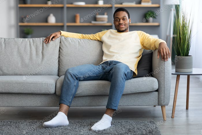 Handsome african american young man chilling at home